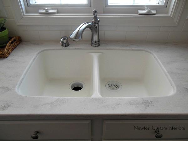 Kitchen reveal kitchen countertops newton custom interiors for Quartz integrated sink