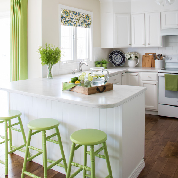 Fabulous white kitchen renovation. Love the pops of color against the white background!