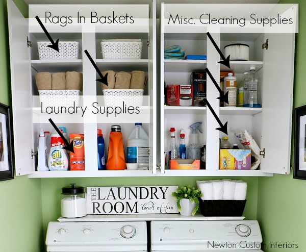 Organizing supplies in laundry room cabinet.