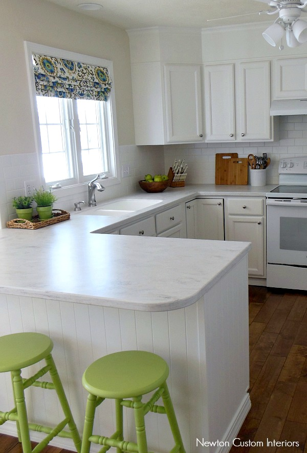Our White Kitchen Reveal - check out how our kitchen was updated. No more 90's orange oak!