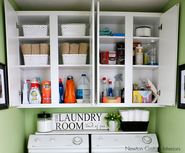 Organizing A Small Laundry Room - Tips for organizing a small laundry room that is really just a closet by adding cabinets for more functional storage.