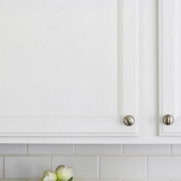 Caulked painted oak cabinets