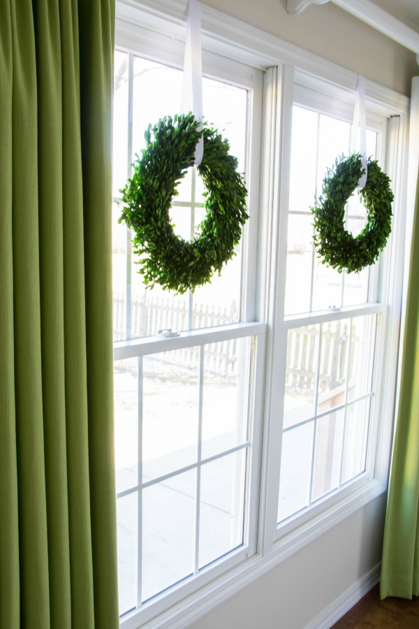 Boxwood wreaths hung in windows are a great way to add some interest.