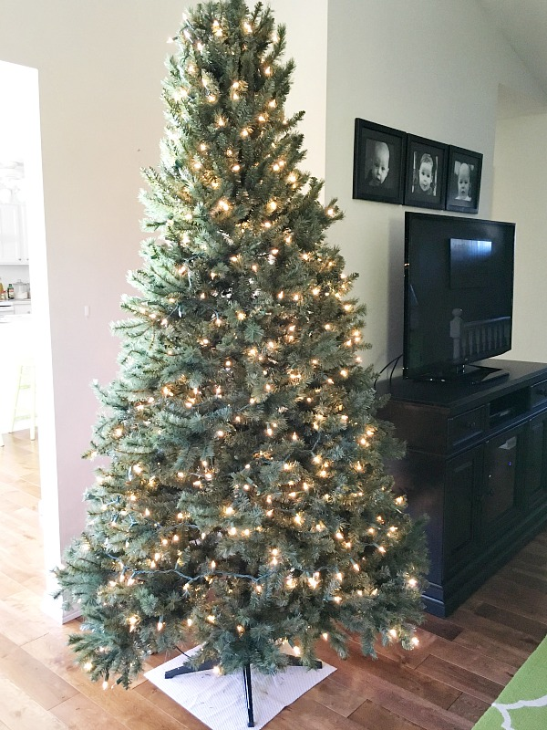 How to decorate a Christmas tree - adding more strands of lights.