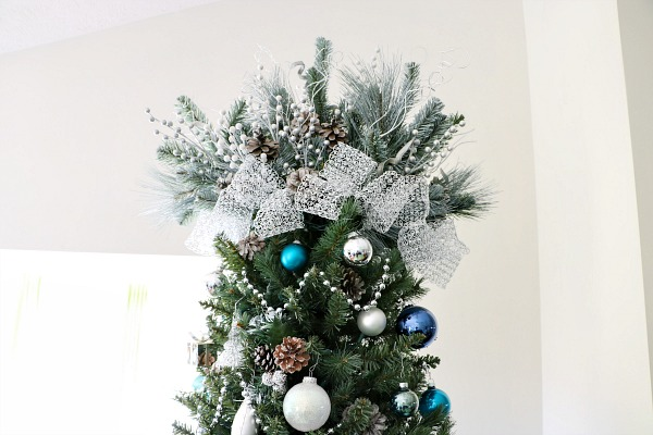 How to decorate a Christmas tree - add a topper.
