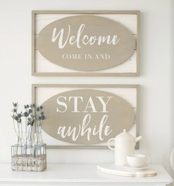 Chalk Couture Welcome & Stay Awhile signs made with their chalk paste.