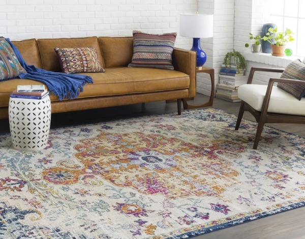Learn how to choose large area rugs that coordinate with your room's decor!