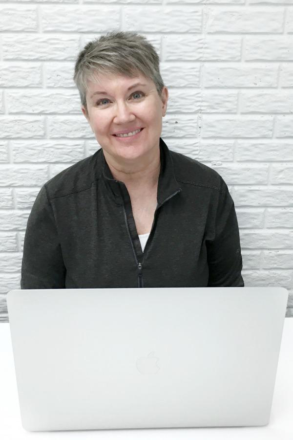 Jann Newton at computer.